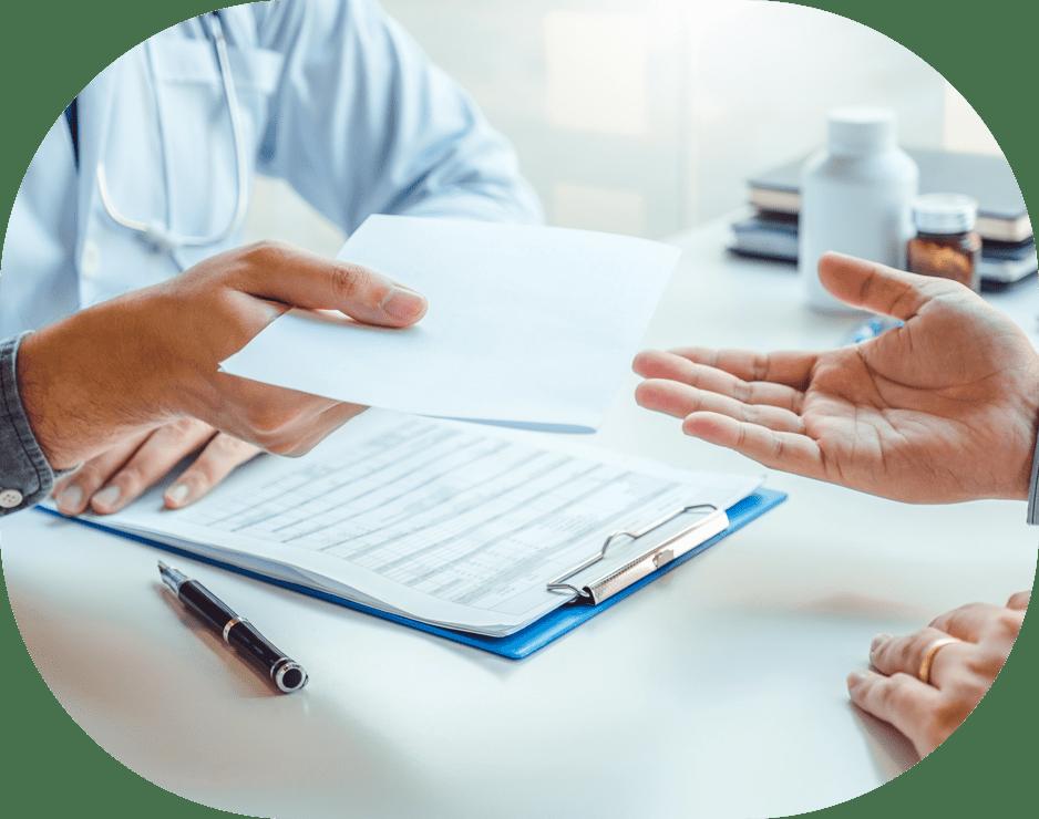 Doctor handing a patient a prescription